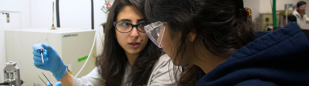 two female students working in chemical engineering lab