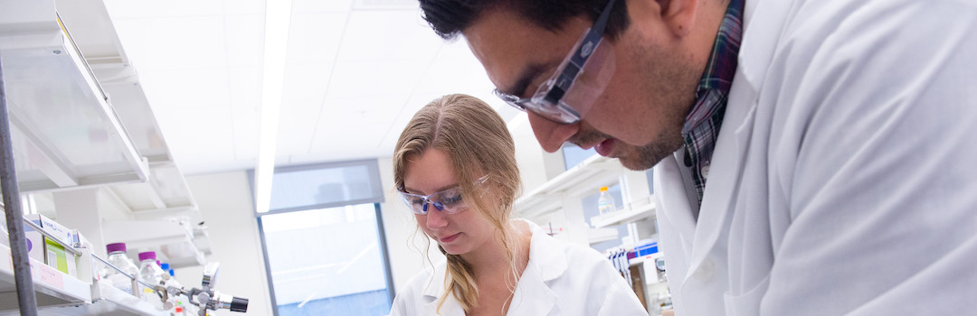 a man and woman working in lab